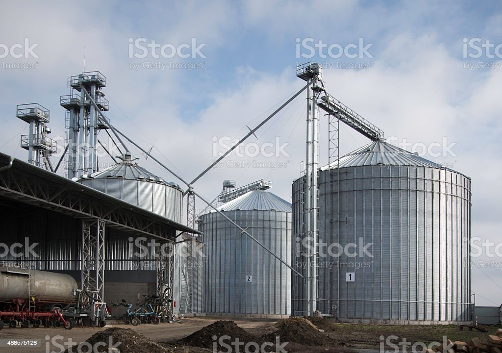 Row of granaries for storing wheat and other cereal grains stock photo