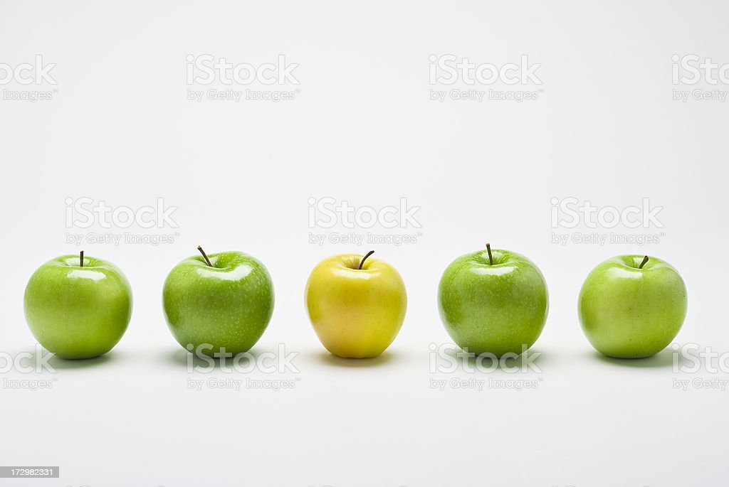 Row of Granny Smith Apples one Golden Delicious All Organic royalty-free stock photo