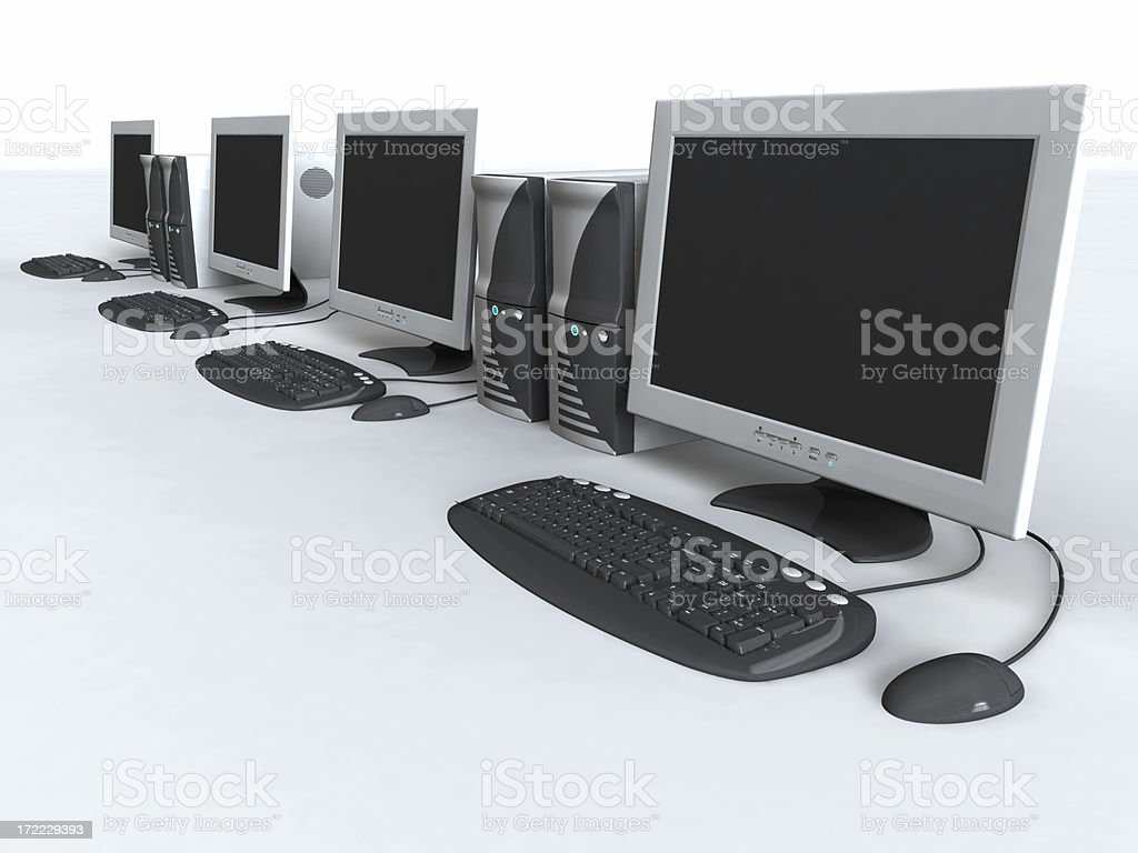 Row of gray and black computer desk tops on white back stock photo