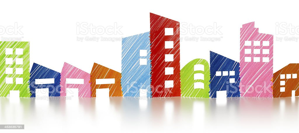 Row of hand coloured paper chain office and factory buildings stock photo