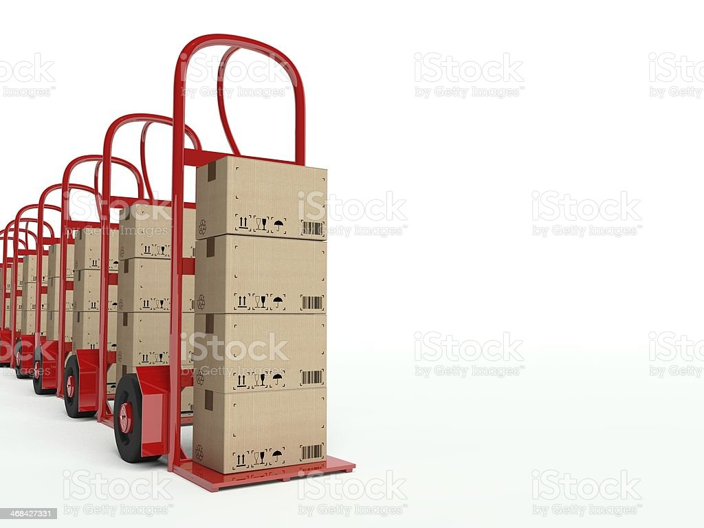 Row of hand trucks with cardboard boxes royalty-free stock photo