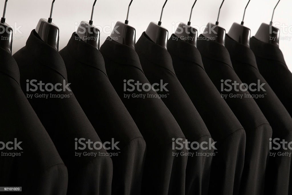 Row of hanging suits royalty-free stock photo
