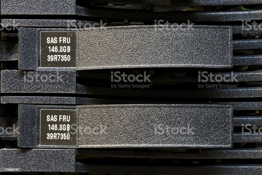 Row of hard drives mounted  rack in a data center royalty-free stock photo