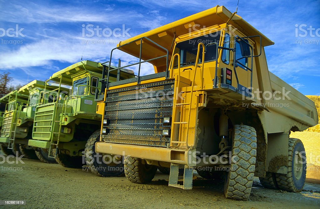 Row of heavy duty dump trucks royalty-free stock photo
