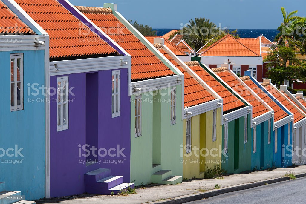 Row of houses and the deep blue ocean stock photo