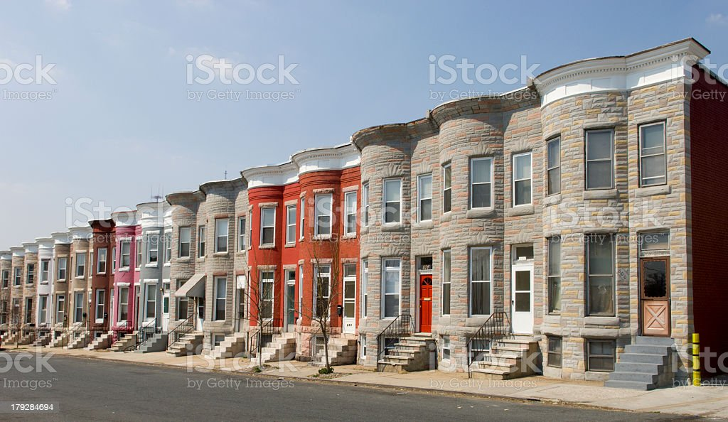 Row of identical houses on a street stock photo