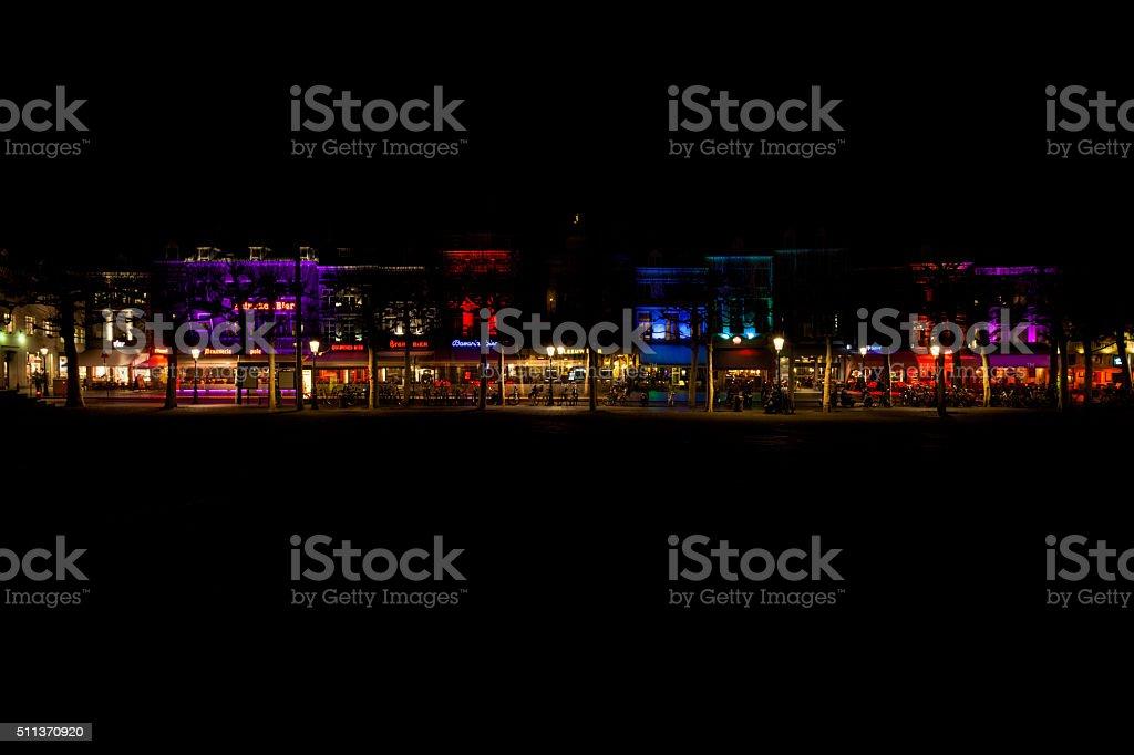 Row of illuminated establishments at night, Maastricht, The Netherlands. stock photo