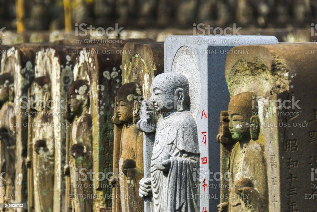 Row of jizo statues stock photo