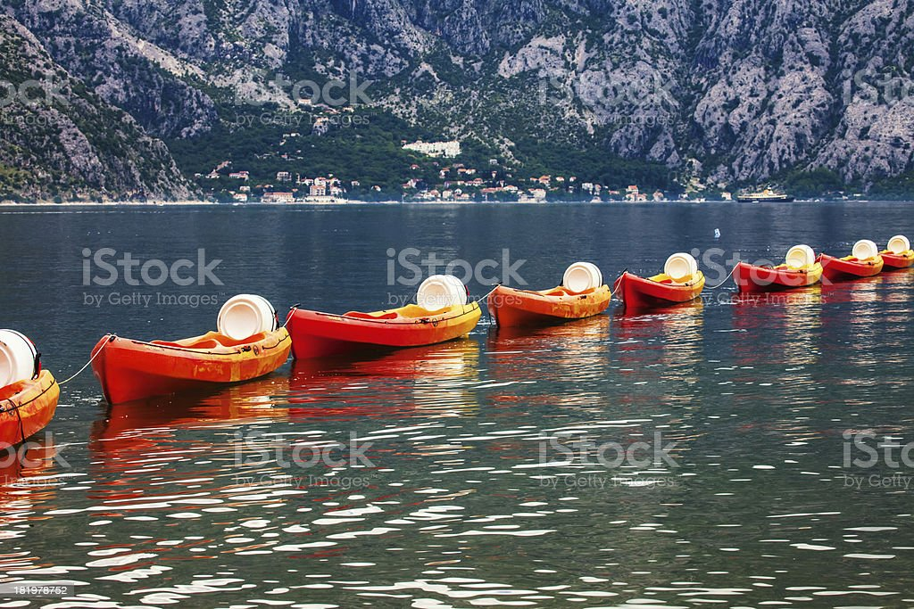 Row of kayaks in the sea royalty-free stock photo