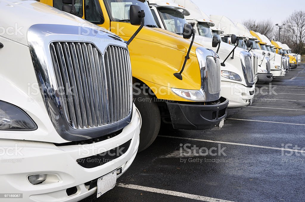 row of large trucks stock photo