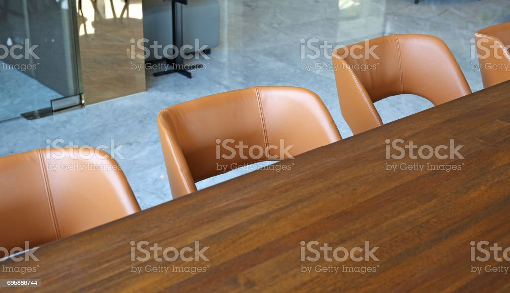 Row of leather chair and wood table. stock photo