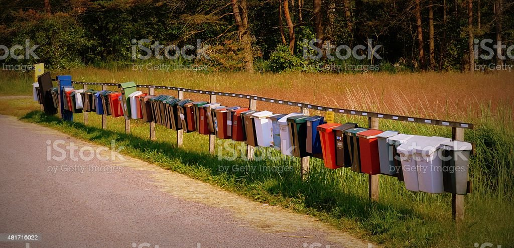 Row of letterboxes in the Swedish countryside stock photo