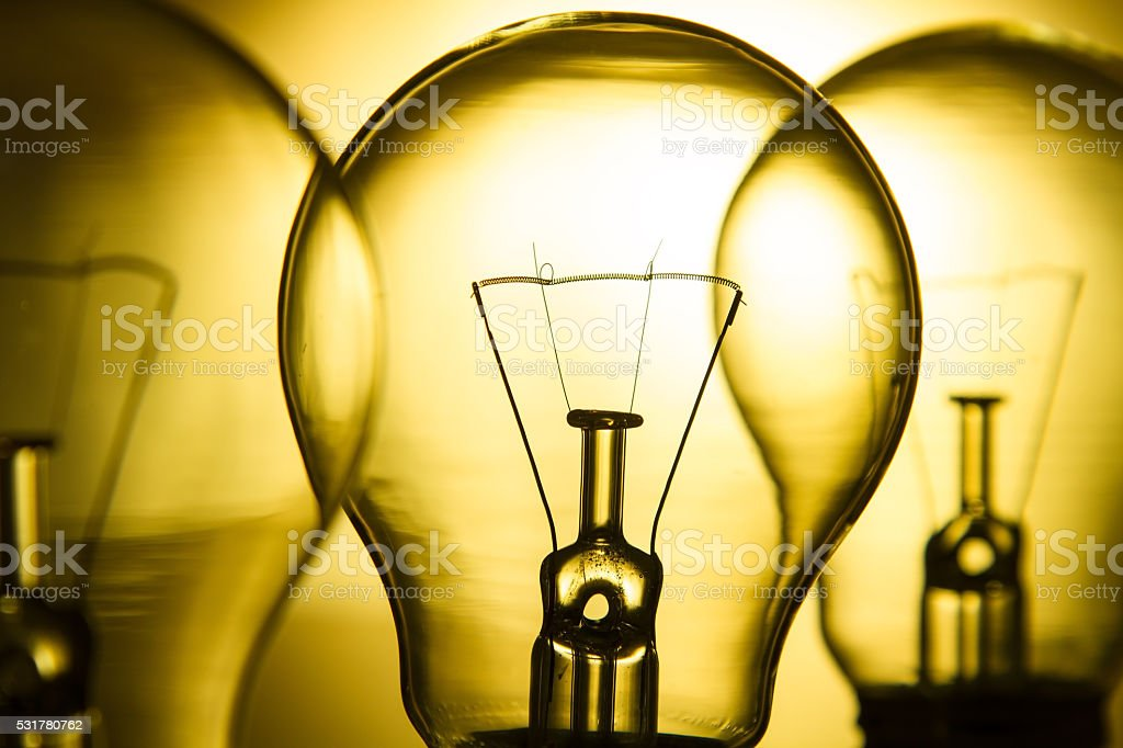 Row of light bulbs on a bright yellow background stock photo