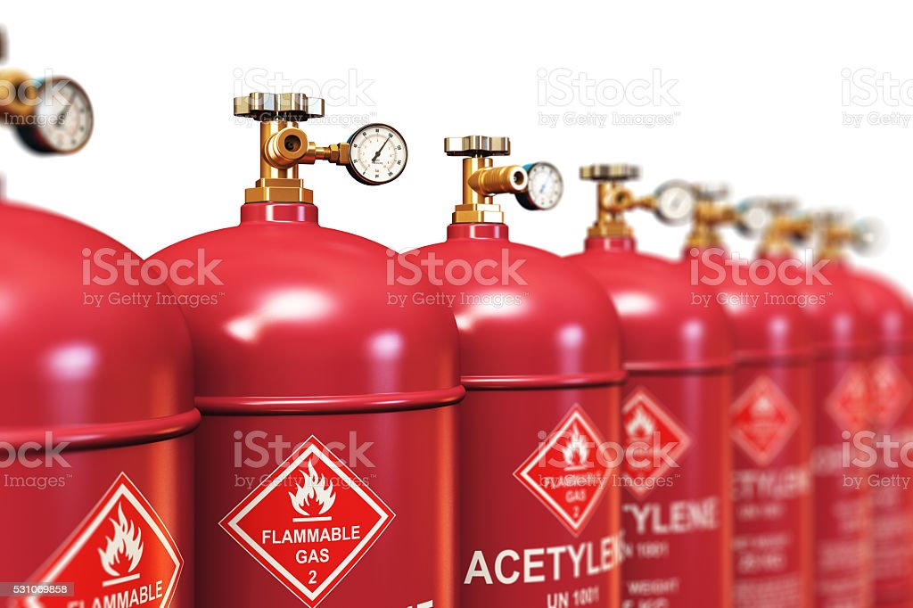 Row of liquefied acetylene industrial gas containers stock photo