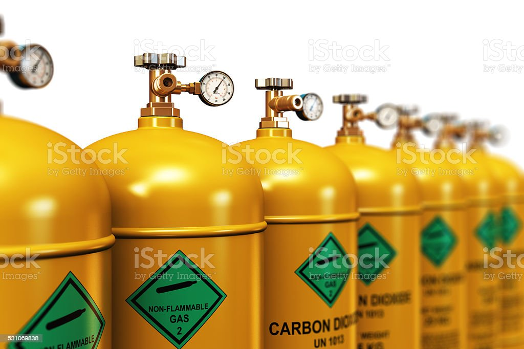 Row of liquefied carbon dioxide industrial gas containers stock photo
