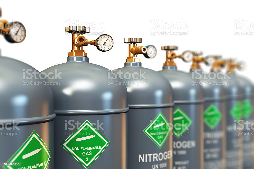 Row of liquefied nitrogen industrial gas containers stock photo