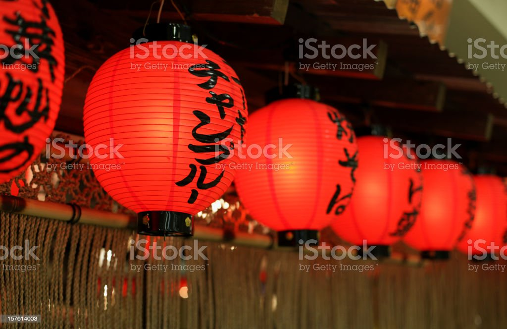 A row of lit Japanese lanterns stock photo