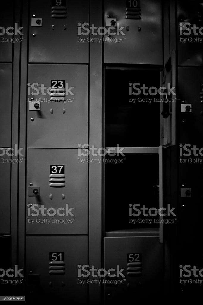 row of lockers with dramatic lighting stock photo