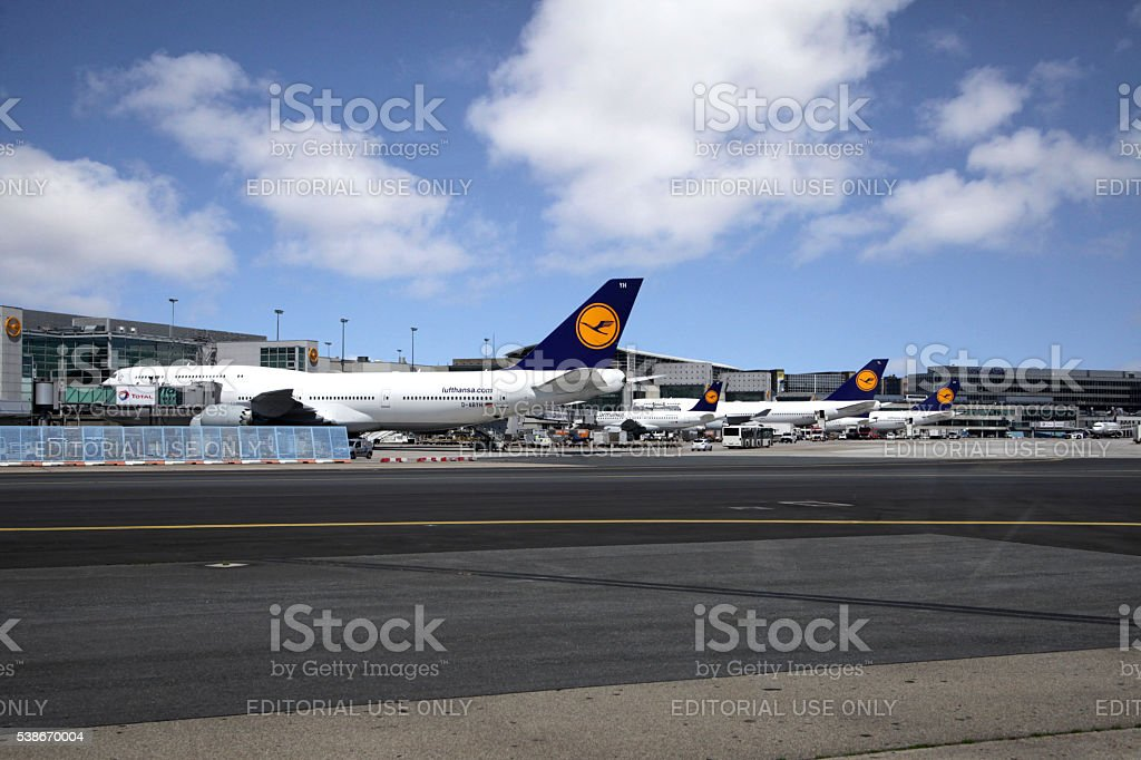Row of Lufthansa airliners parked at Frankfurt international airport. stock photo