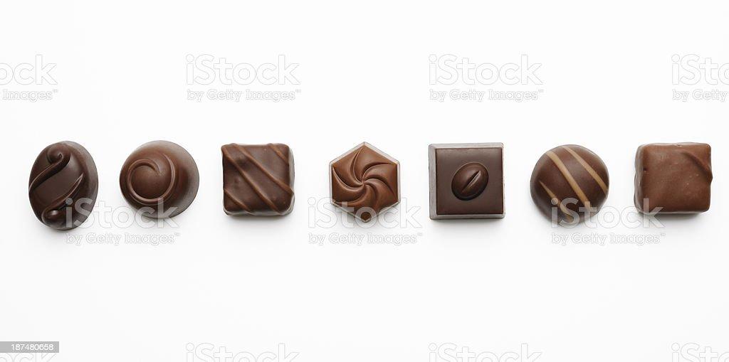 Row of luxury chocolates on white background stock photo