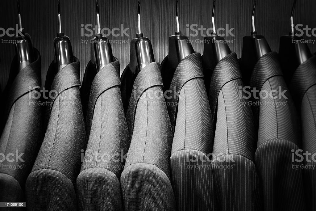 Row of men suit jackets. stock photo
