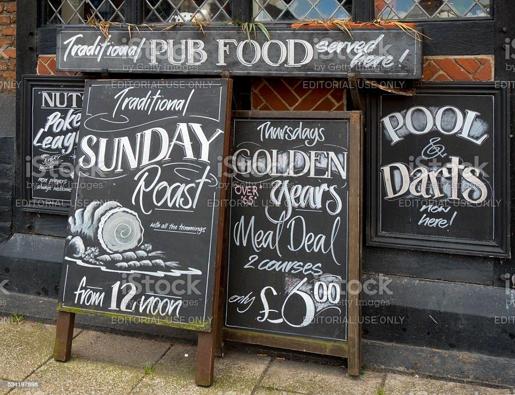 Row of menu boards outside a pub stock photo