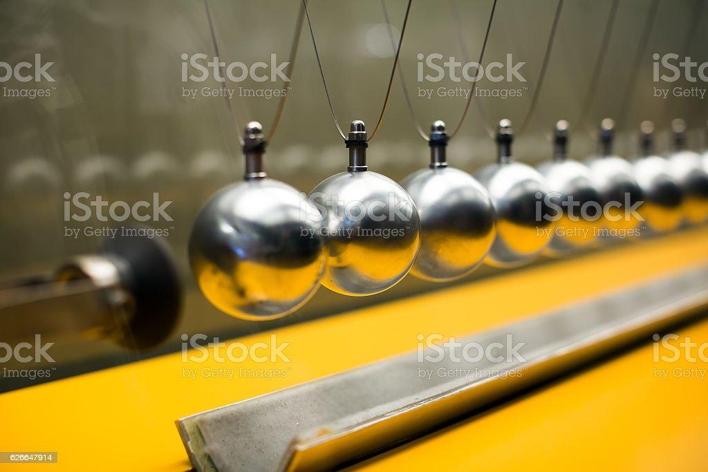 Row of metallic balls for inertia experiments stock photo