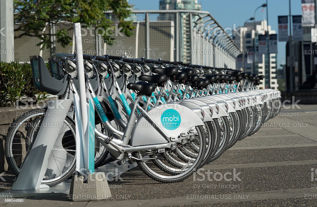 Row of MOBI public bikes for rent. stock photo
