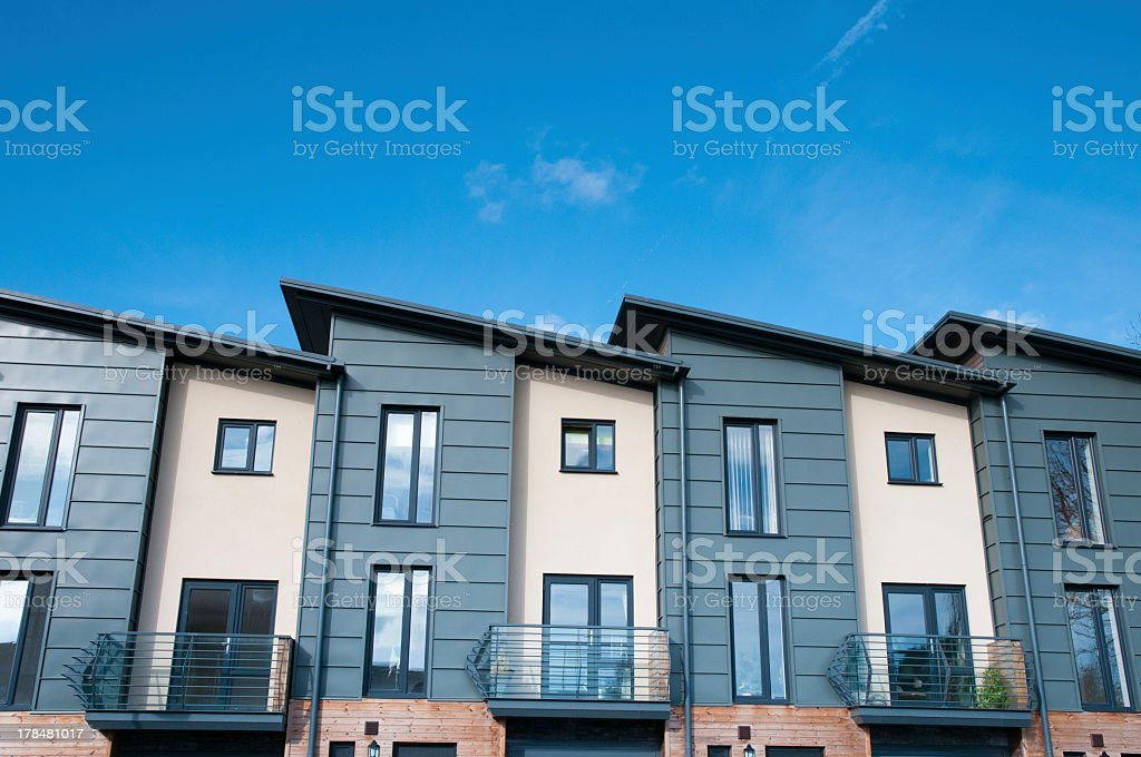 Row of modern terraced townhouses stock photo