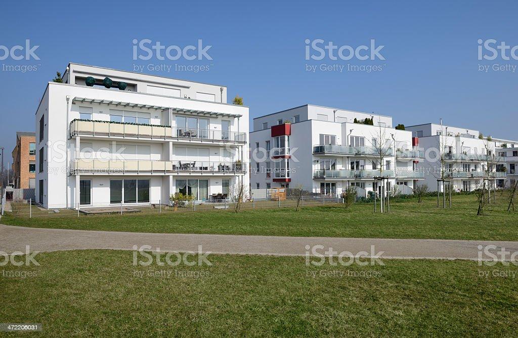 Row of modern white apartment houses royalty-free stock photo