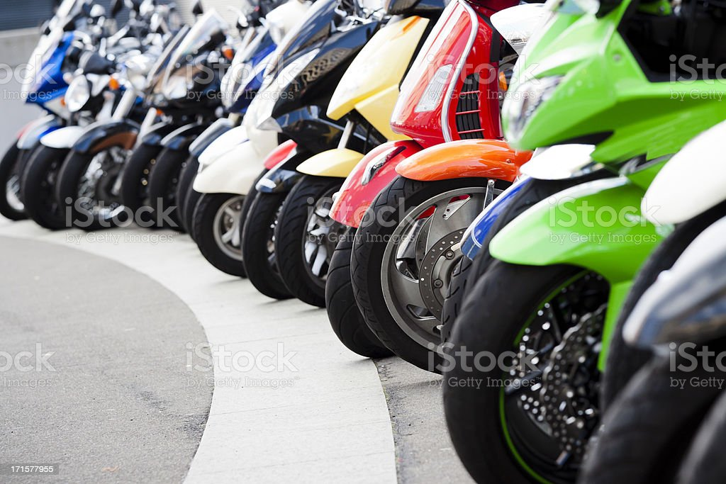 Row of motor scooters standing on the street, copy space stock photo
