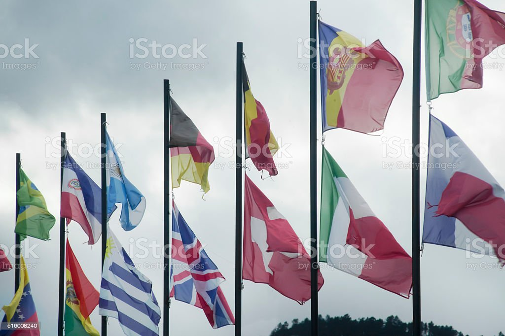 Row of multicolored flags stock photo