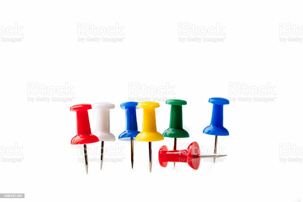 Row of multicolored thumbtacks stock photo