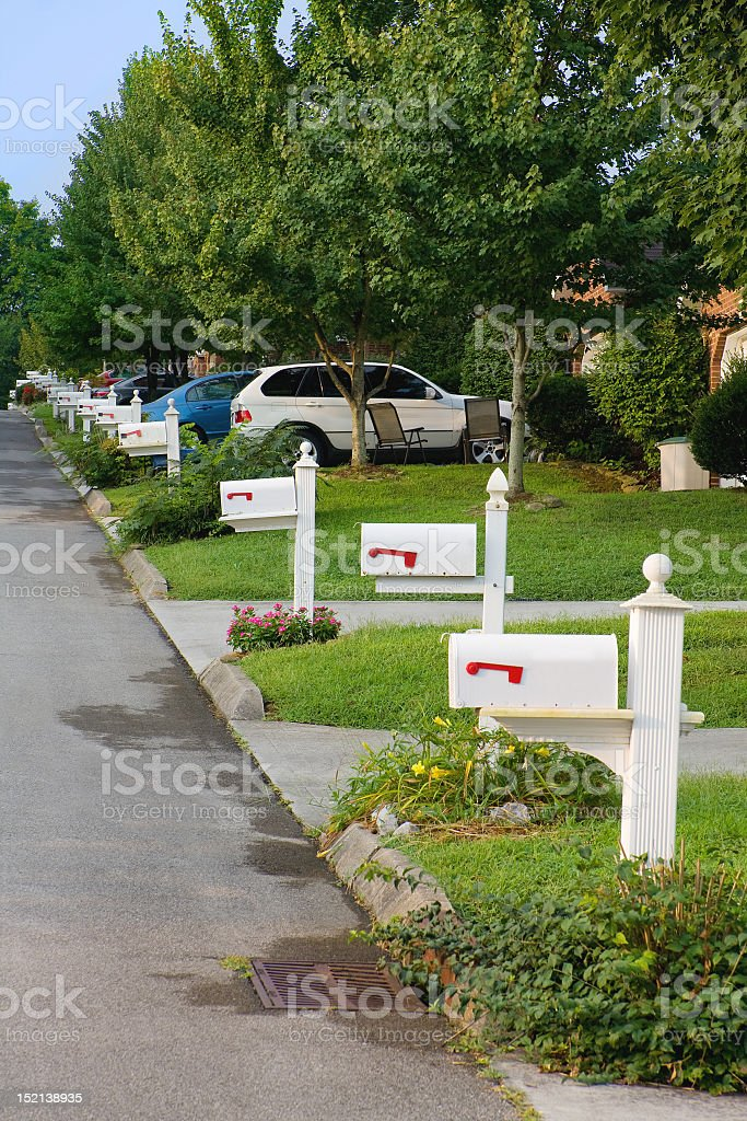 A row of neighborhood mailboxes stock photo