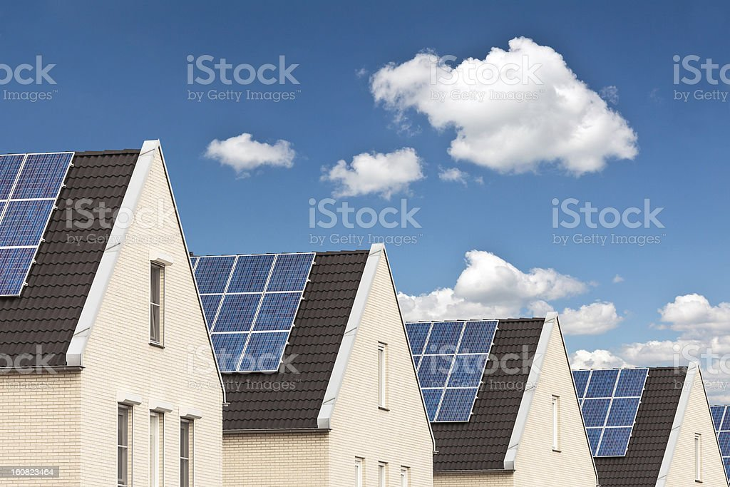 Row of new houses with solar panels stock photo