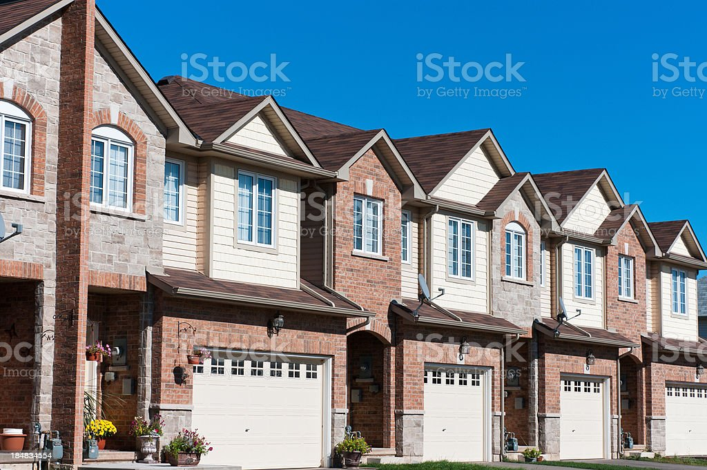 A row of newly built residential housing with front garages stock photo
