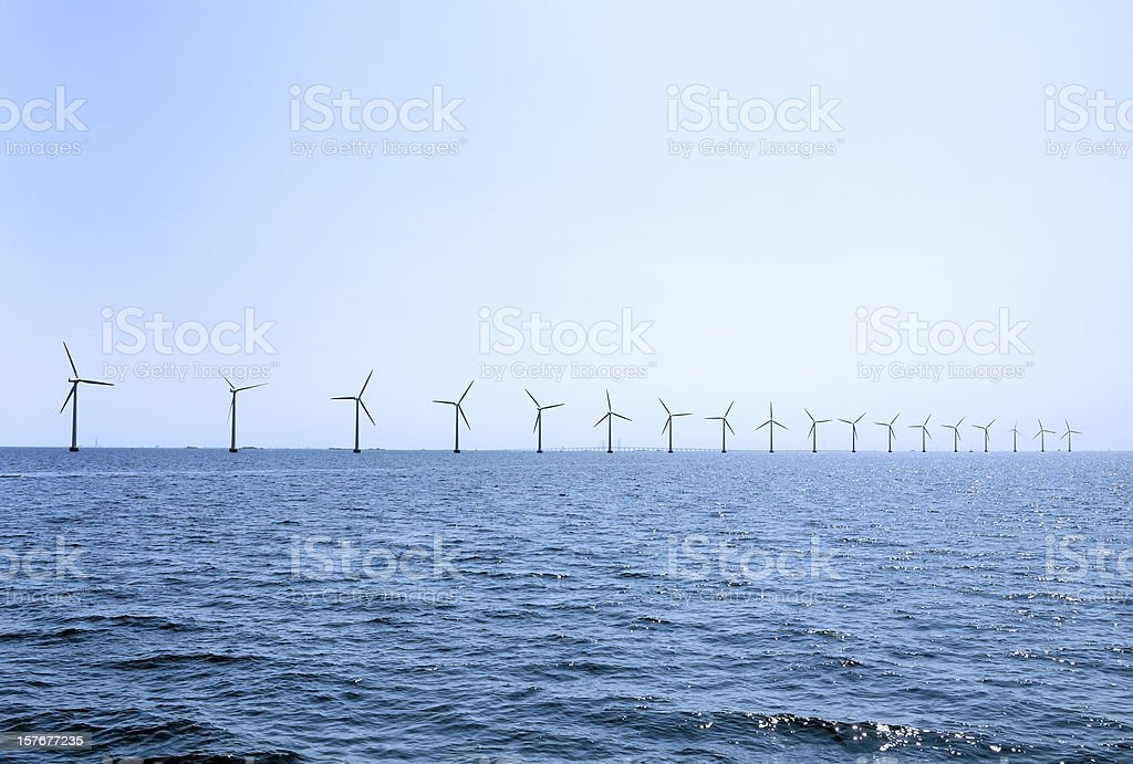 Row of offshore wind turbines outside Copenhagen, Denmark stock photo