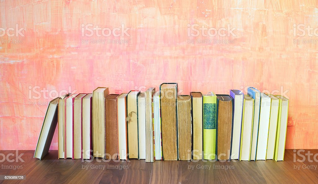 row of old books on grungy background stock photo