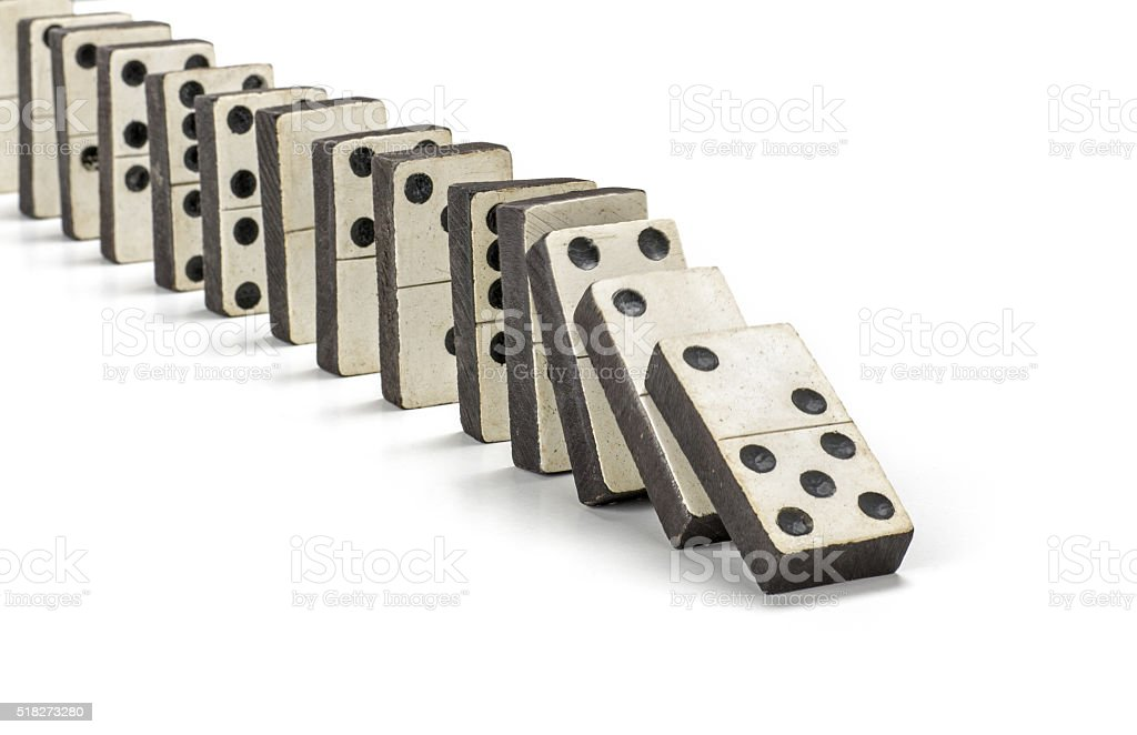 row of old dominoes stock photo