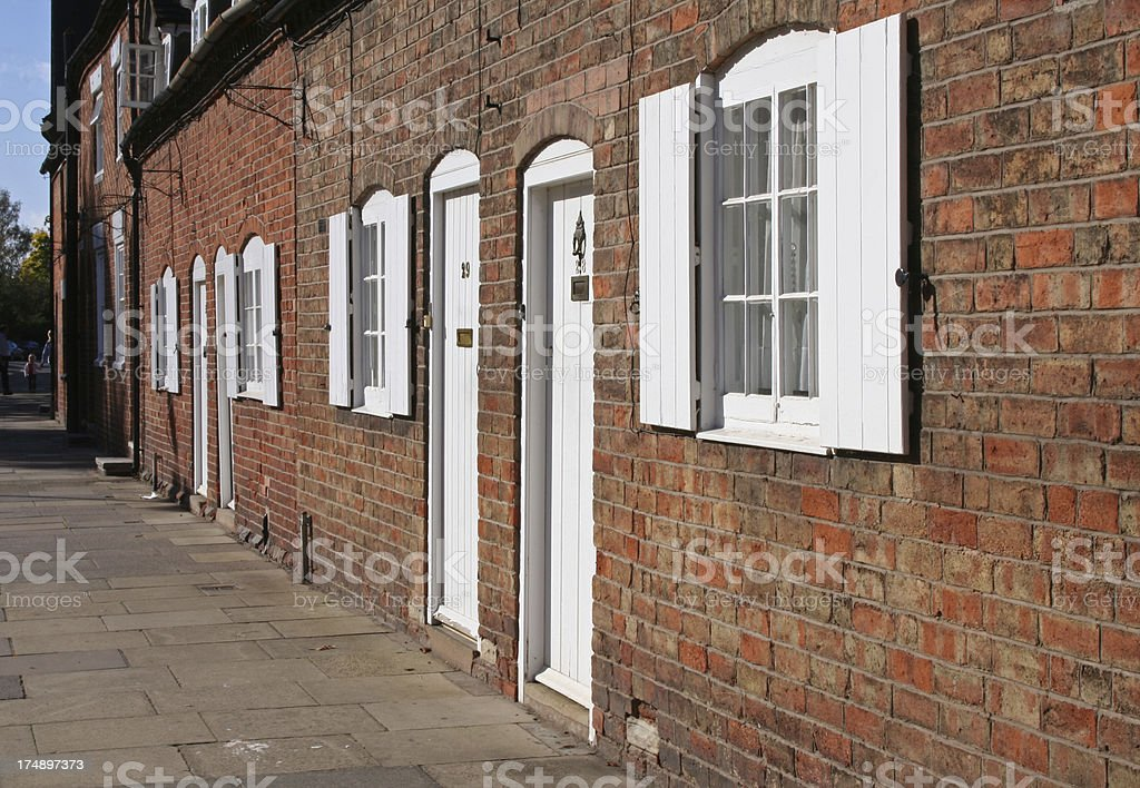 row of old houses with shutters royalty-free stock photo