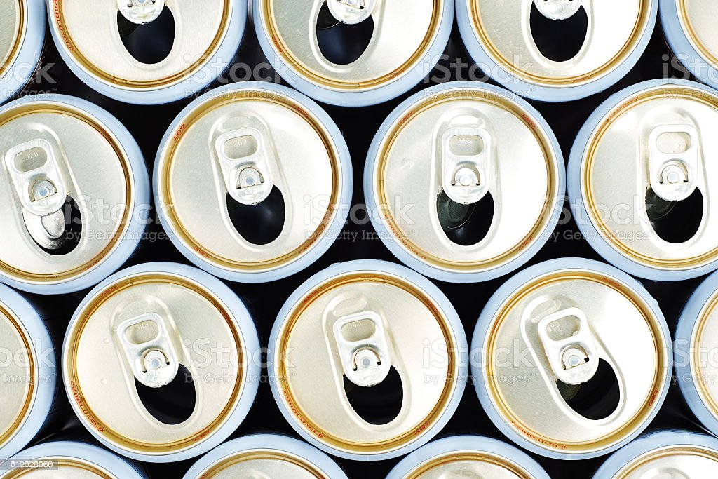 row of opened beer cans, top view stock photo