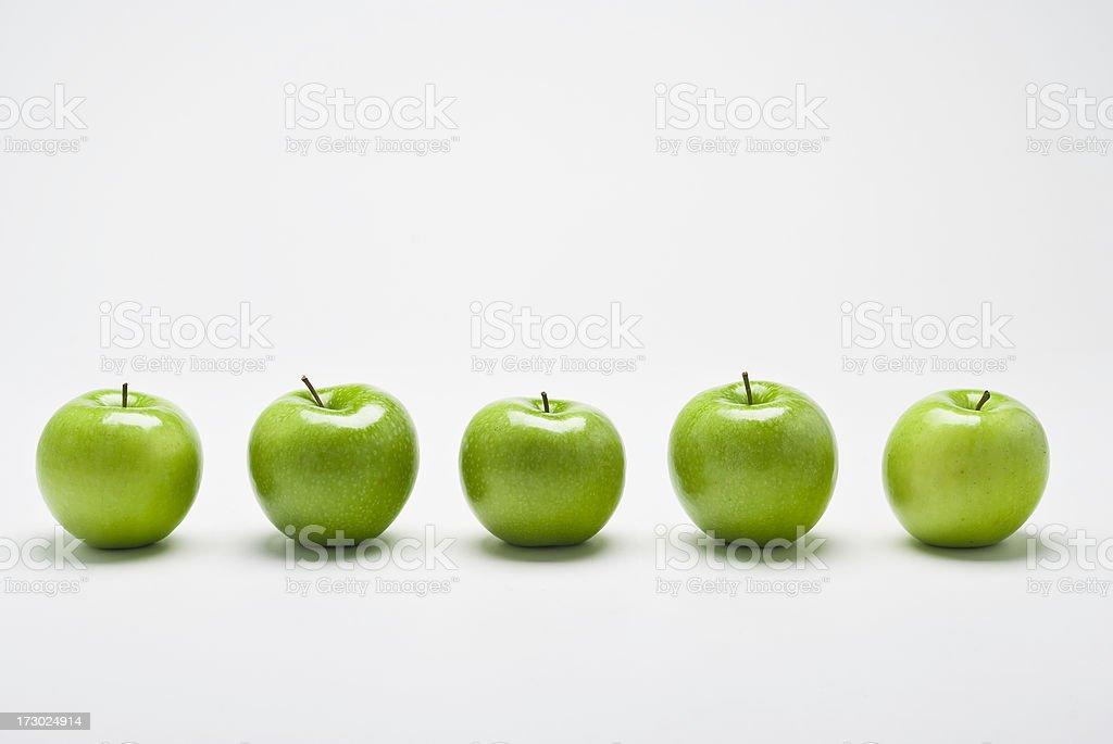 Row of Organic Granny Smith apples royalty-free stock photo