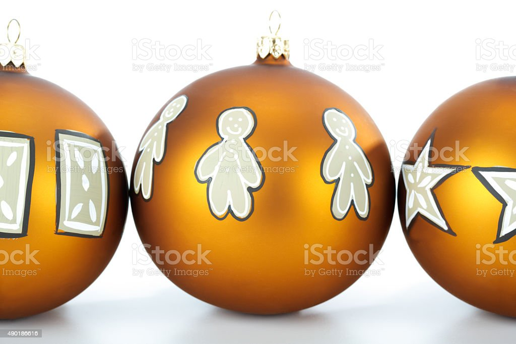 Row of painted Christmas baubles stock photo