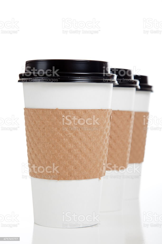Row of paper coffee cups on white royalty-free stock photo