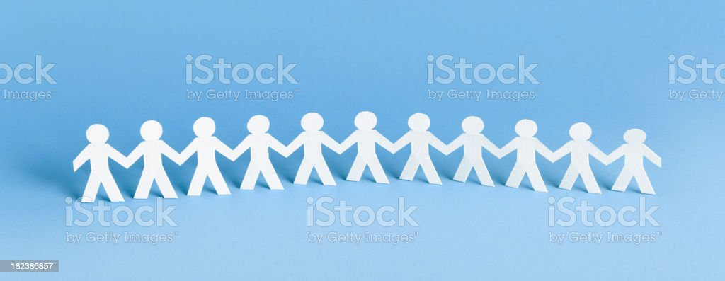 Row of paper people stock photo