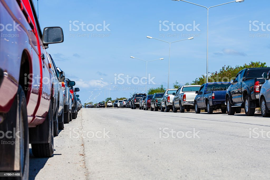 row of parked cars in parking lot stock photo