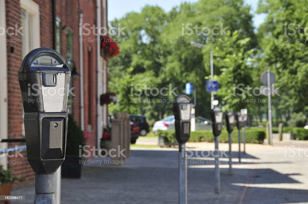 Row of parking meters - differential focus stock photo
