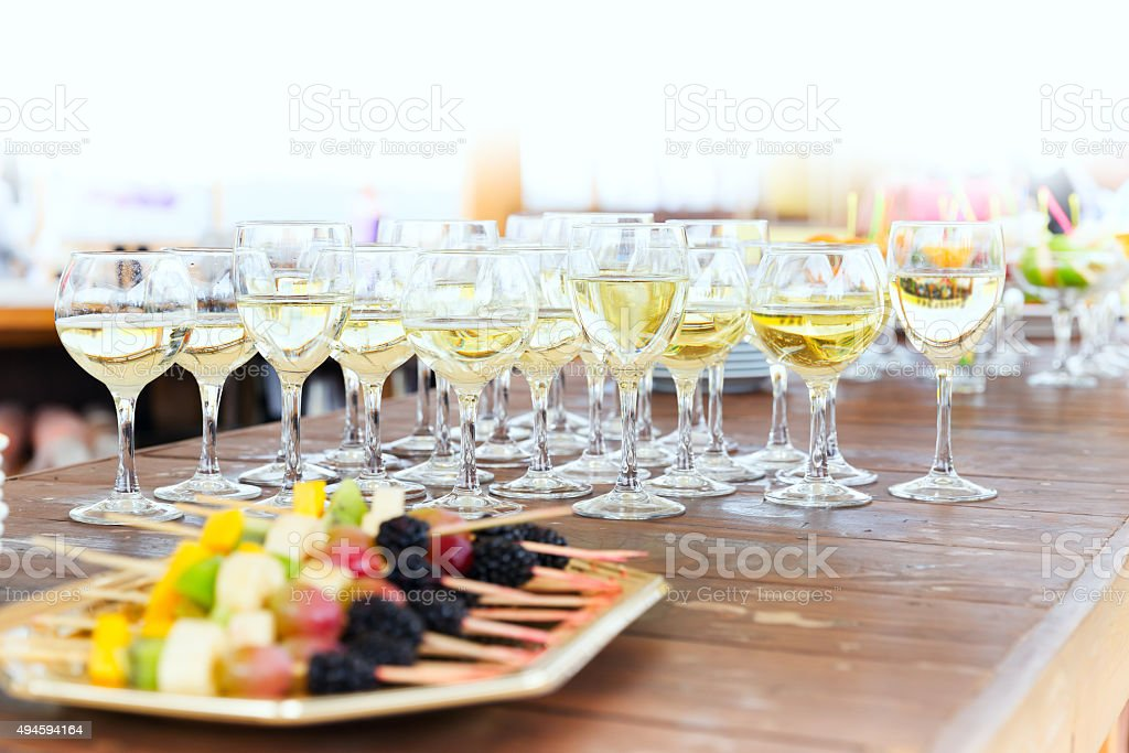 Row of party champagne glasses stock photo