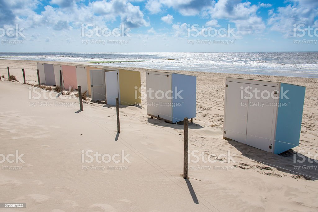 Row of pastel colored beach cabins stock photo