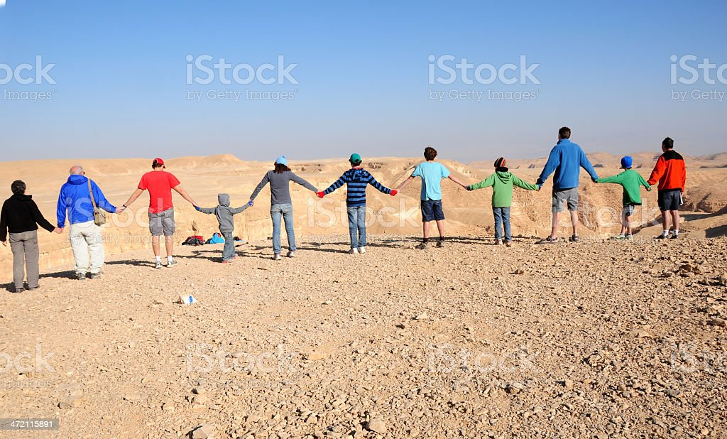 Row of people holding hands, Israel's Negev Desert stock photo